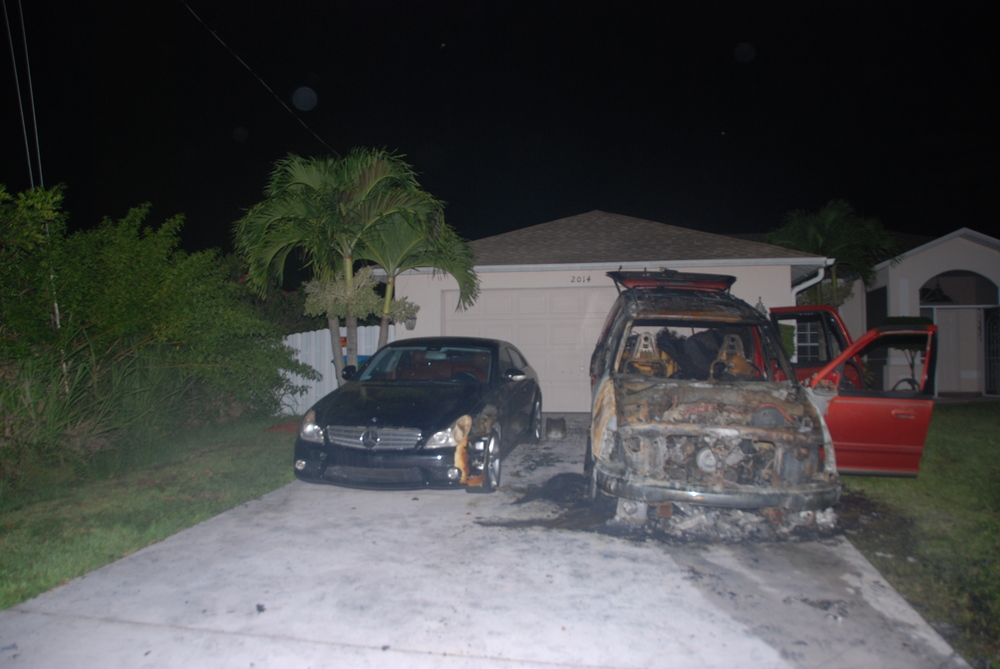 PHOTO:  On Saturday at 8:30 PM, Cape Coral Police Department received numerous calls regarding a fire at 2014 NW 25 Place, Cape Coral.  Cape Coral Fire and Police units responded to the scene, finding a large fire with billowing, toxic smoke, involving two vehicles parked in the residence's driveway just feet from the home.  Cape Coral Fire Department personnel extinguished the fire, which is now thought to be suspicious in nature.  (Photo Courtesy of Cape Coral Police Department)