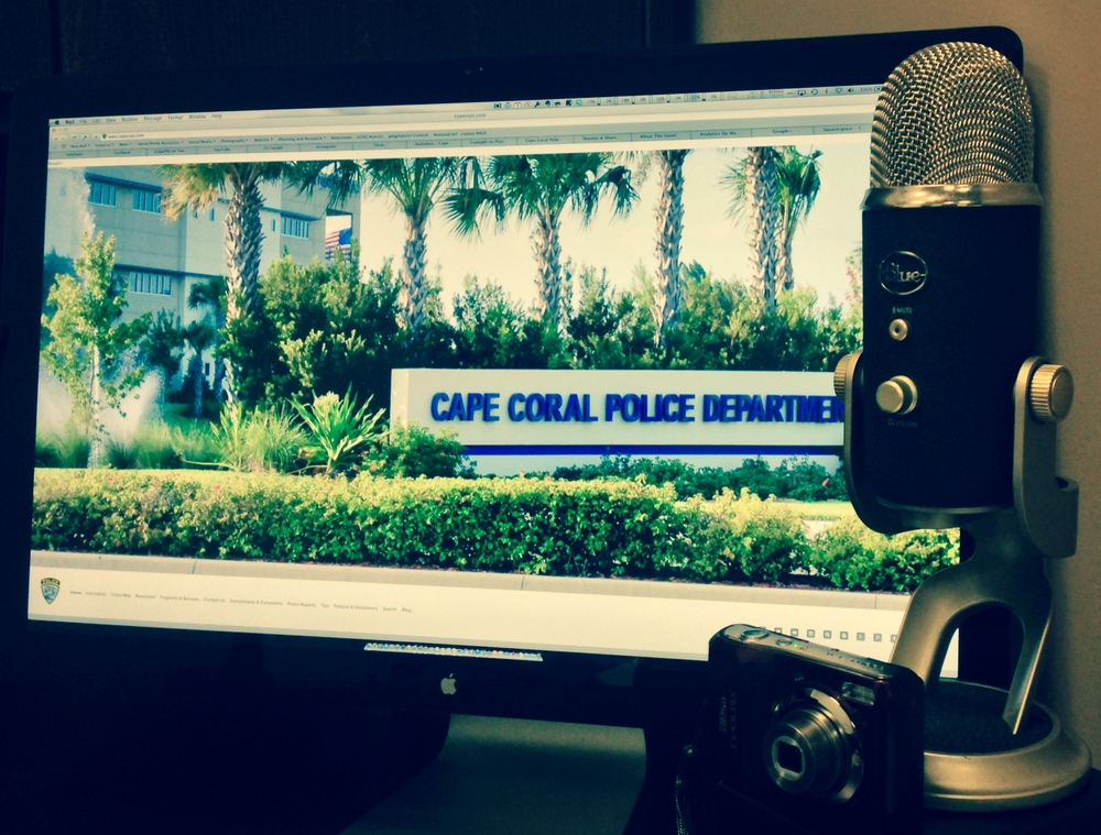 PHOTO:  A shot from the Public Affairs office showing the capecops.com website on-screen with a microphone and camera in the foreground.  The new Cape Coral Police Department Blog will be a general interest format offering more varied content.  (Photo Courtesy of Cape Coral Police Department)