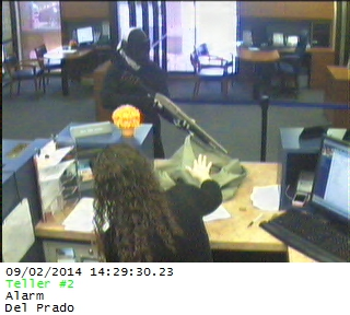 PHOTO:  At around 2:30 PM, a W/M suspect wearing a mask and goggles, armed with a shotgun entered the bank and demanded cash.  The suspect was given an undisclosed sum of US currency, and he left the bank.  (Photo Courtesy of Cape Coral Police Department)