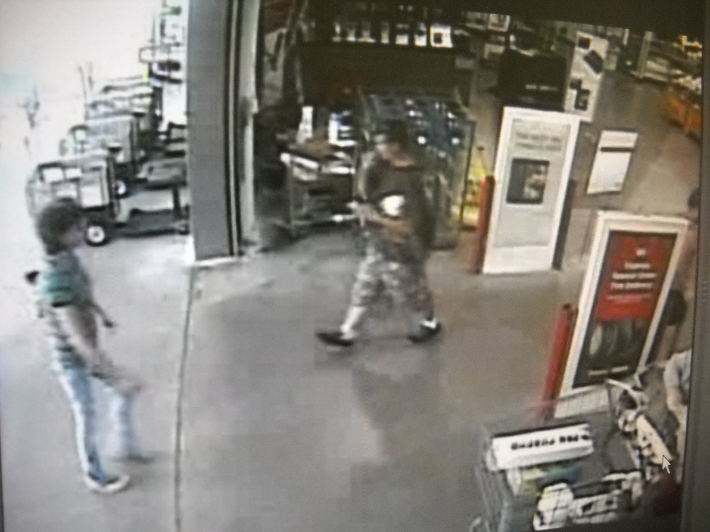 "PHOTO:  Video surveillance shows a white male in his mid-twenties to early thirties, with a thin build, and average height (5`9""- 6`0"").  The male had short brown hair and was wearing sunglasses on top of his head.  He was wearing a light gray or brown t-shirt and long camouflage shorts of the same color with white socks and black shoes..  (Photo Courtesy of Cape Coral Police Department)"