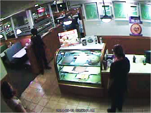 PHOTO:  Armed Robbery suspects- Both suspects were completely covered from head to foot,  making it extremely difficult to obtain accurate descriptions from witnesses. The first suspect wore a black, long-sleeved shirt, and had a silver revolver. The other suspect had on a white long-sleeved shirt and socks over his hands.  (Photo Courtesy of Cape Coral Police Department)
