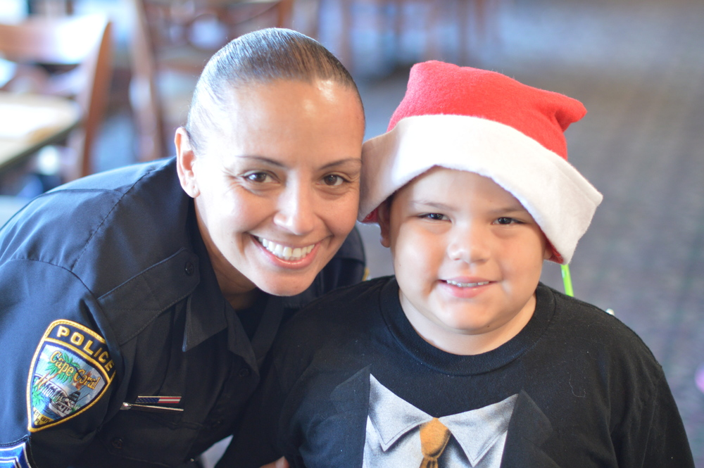 PHOTO: Office Jasmine Correa takes time to pose with her shopping buddy. (Photo Courtesy of Cape Coral Police Department)