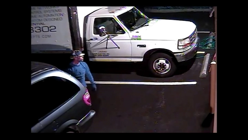 "PHOTO:  Surveillance video shows the suspect arriving in a blue Chrysler minivan with a white female driver.  The male's description is 5'09"" to 6'00"" feet tall, 180-190 pounds, wearing a camouflage boonie hat, blue sweatshirt, black gloves, khaki shorts and white sneakers.  The male had a short fade-style haircut with no facial hair.  (Photo Courtesy of Cape Coral Police Department)"