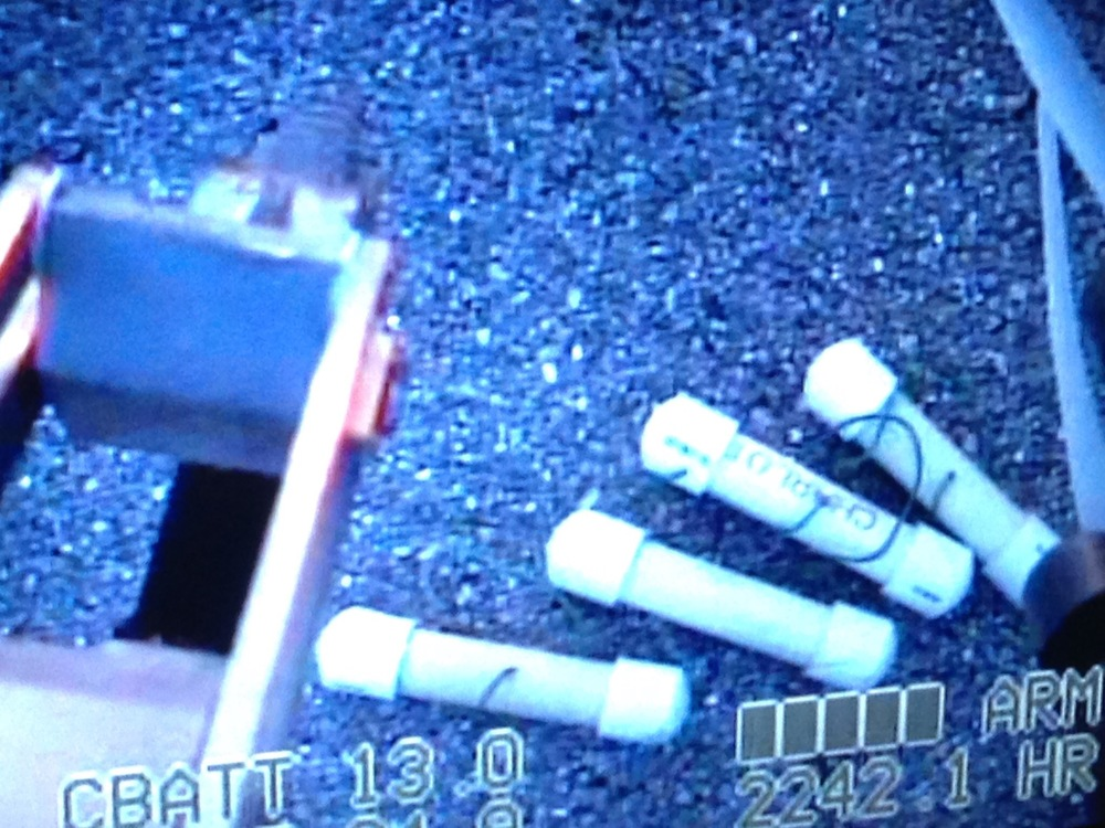 PHOTO:  Remote camera footage of several pipe bombs located in an old golf bag.  (Photo Courtesy of Cape Coral Police Department and LCSO )