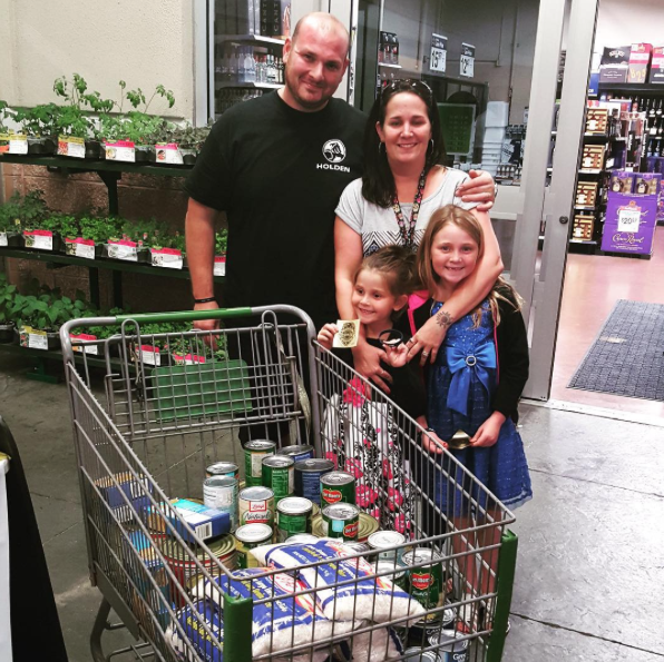 PHOTO:   This family surprised us by purchasing a loaded shopping cart specifically for the Holiday Heroes canned food drive. Thank you for being heroes for families in need! .  (Photo Courtesy of Cape Coral Police Department)