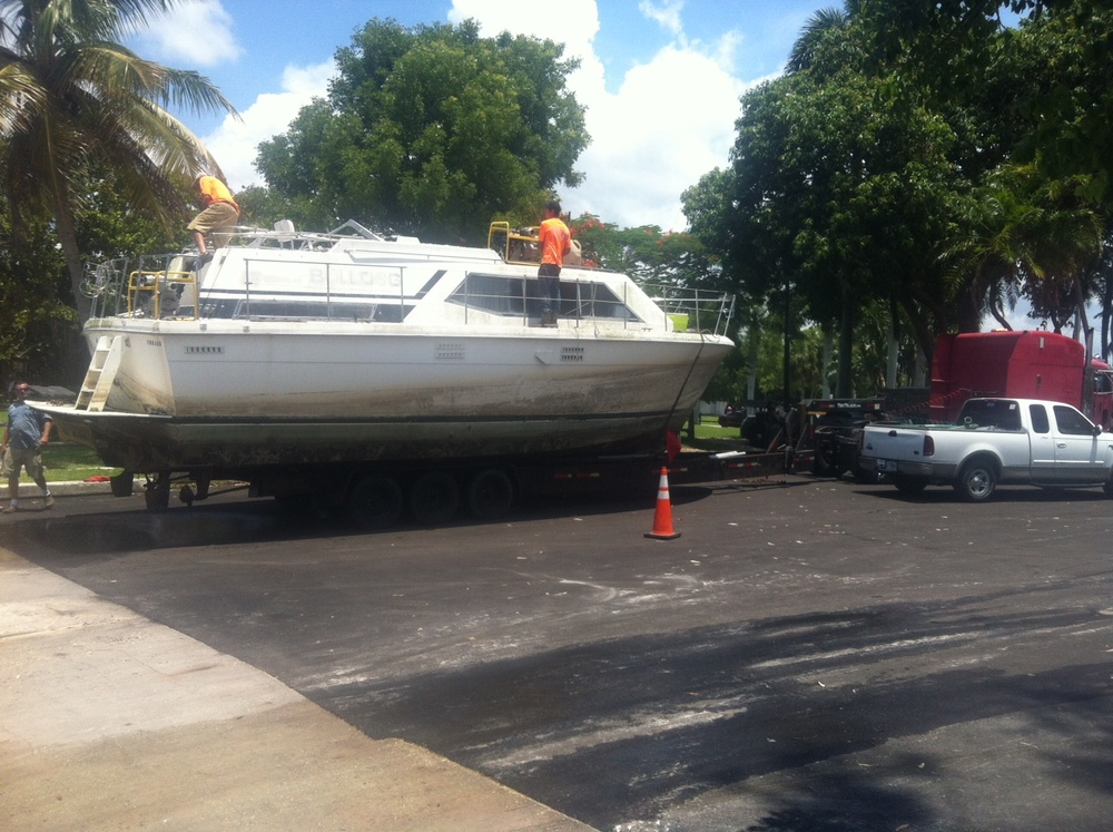 "PHOTO:  The derelict vessel ""Bulldog"" was removed from a canal in the 1100 block of Lucerne Avenue Tuesday afternoon, thanks to the cooperation of several local, state, and federal agencies.  (Photo Courtesy of Cape Coral Police Department)"
