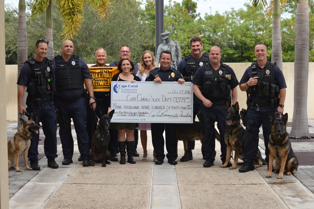 PHOTO:  The Cape Coral Police Department K9 Unit, Special Operations Lieutenant along with Chief Dave Newlan and Police Grant Writer Shannon Northorp, accept the grant from the Ben Roethlisberger Foundation, presented by the Cape Coral Community Foundation.  (Photo Courtesy of Cape Coral Police Department)