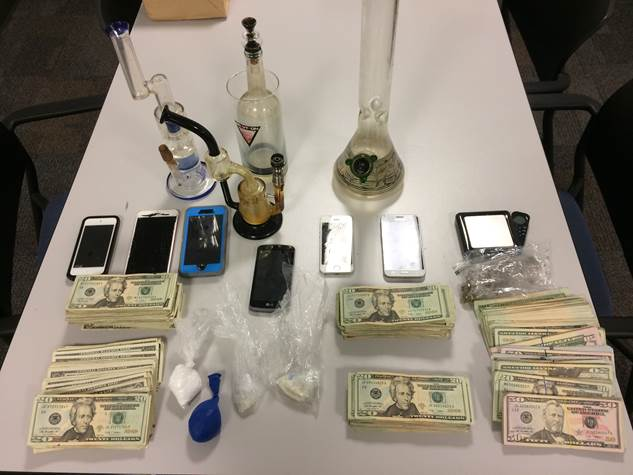 PHOTO:  Narcotics, cash, paraphernalia, and cell phones were seized in a search warrant served by the Cape Coral Police Department SWAT Team.  (Photo Courtesy of Cape Coral Police Department)