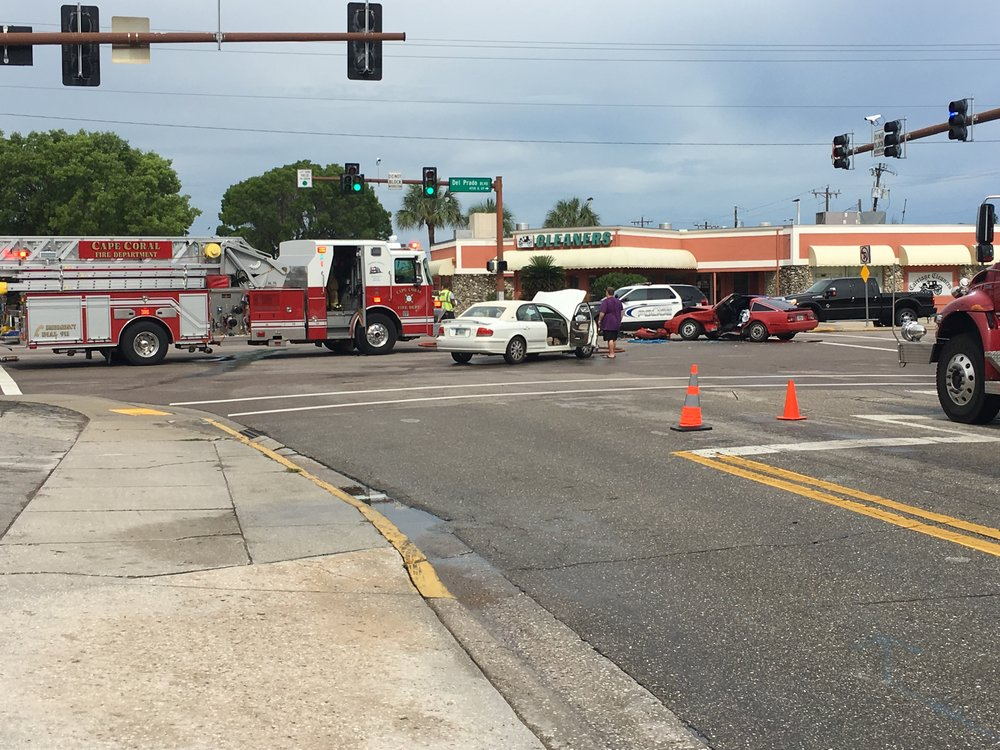 Serious Injury Crash - PHOTO:  PD and FD units respond to a 2-vehicle crash with pin-in at the intersection of SE 47 Terrace and Del Prado Boulevard S.  (Photo Courtesy of Officer J. Zalenski)