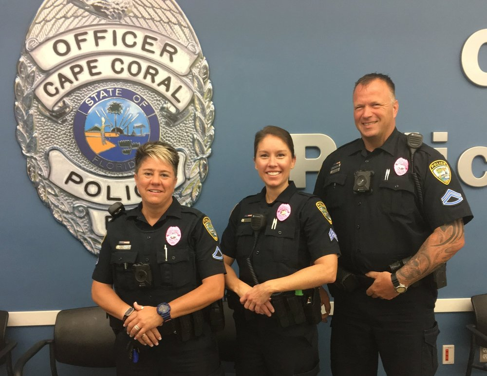 Ofc. Leslie Dunson, Sgt. Julie Medico, and M.Cpl. Ed Schilff show off their pink badges. Pink is definitely your color, Ed! (Photo by Lt. Jon Kulko)