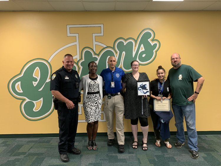 From Left to Right: SRO Dave Zelko, Principal Dr. Michelle Cort-Mora, Officer Mark Amato, Cape Coral Police Department Crime Analyst Deirdra Aliperti, Award Recipient Siara Zapata, and Scott Guelcher - Department Chair, Drawing/Painting, Portfolio, Advanced Placement Studio Art Instructor