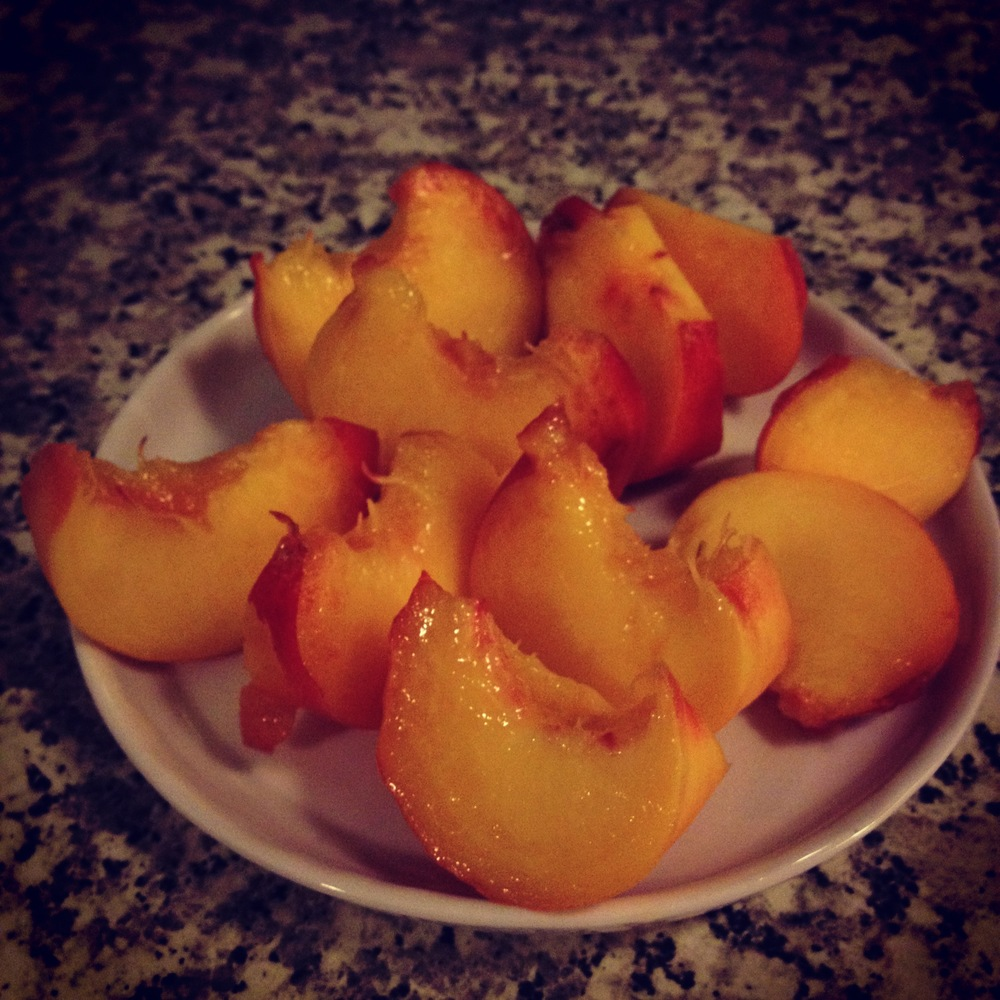 A very ripe donut peach
