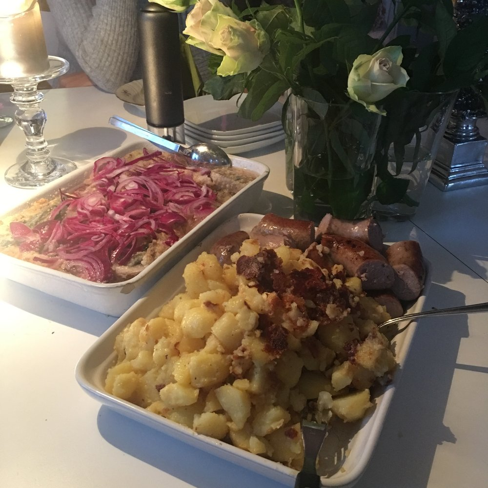 Many of our meals in Copenhagen included herring (here, fried and topped with red onion in brine, potatoes, and pork).