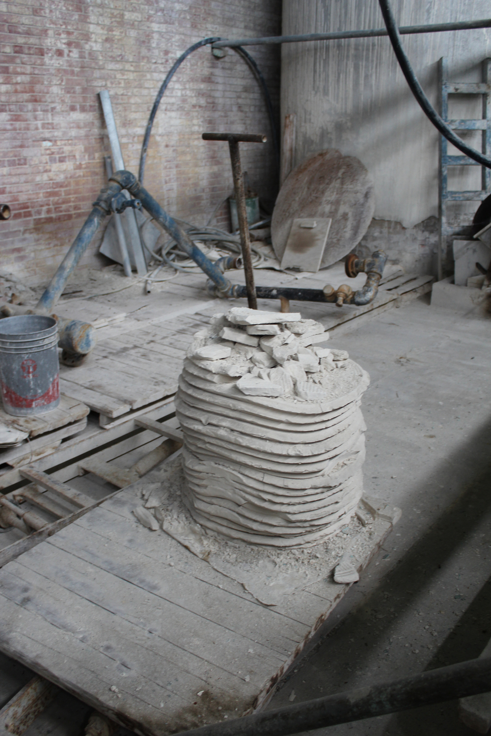 The clay cakes produced by the slip machine.