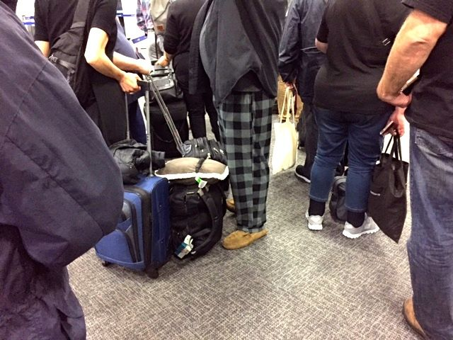 Seasoned traveler in pajamas and slippers at LAX.  Mr. Green observed him 16 hours later as we descended into Sydney Airport, headed to the lavatory with a pair of regular pants over his arm.