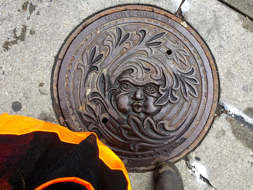 Man hole cover - I guess they're trying to make light of what the North wind feels like here in the winter.