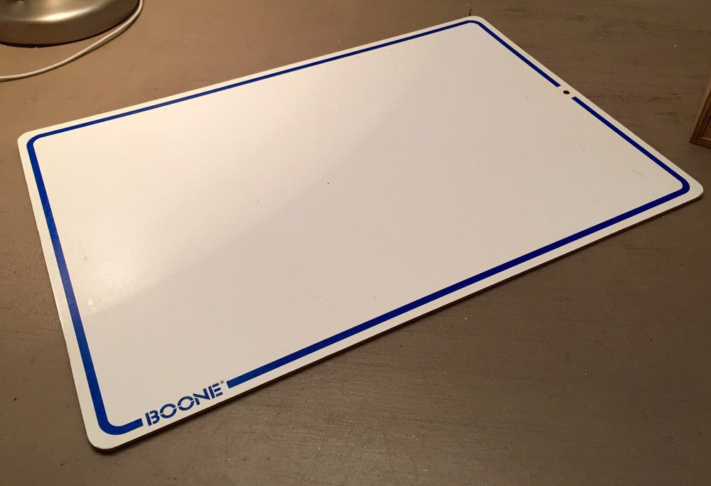 White boards are available for a few dollars online or at the dollar store. There are two benefits to using a white board instead of the top of the cardboard box. 1) Being smooth and monochrome, it's a lot easier on the mouse 2) When you move from standing to sitting and back, the mouse, the keyboard, etc move in one fell swoop.