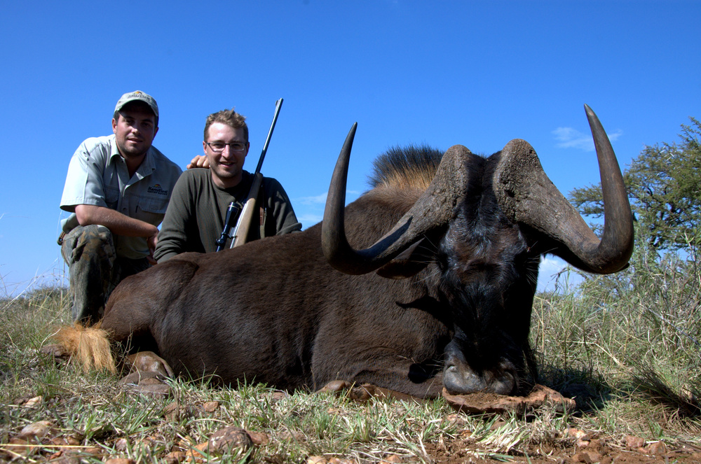 A very happy Adrian Skok with his Black Wildebeest