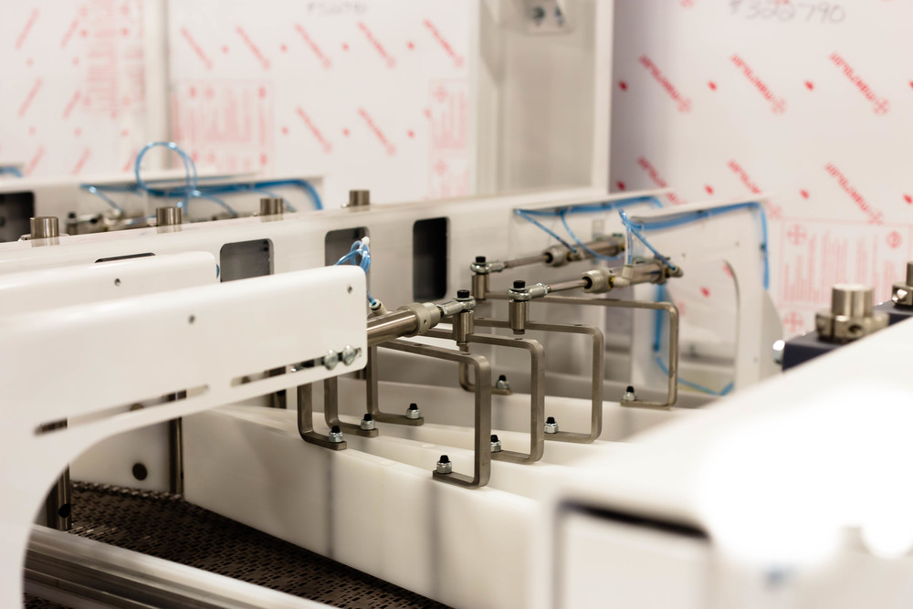 Paddles on a laner, designed for an automated tissue production line.