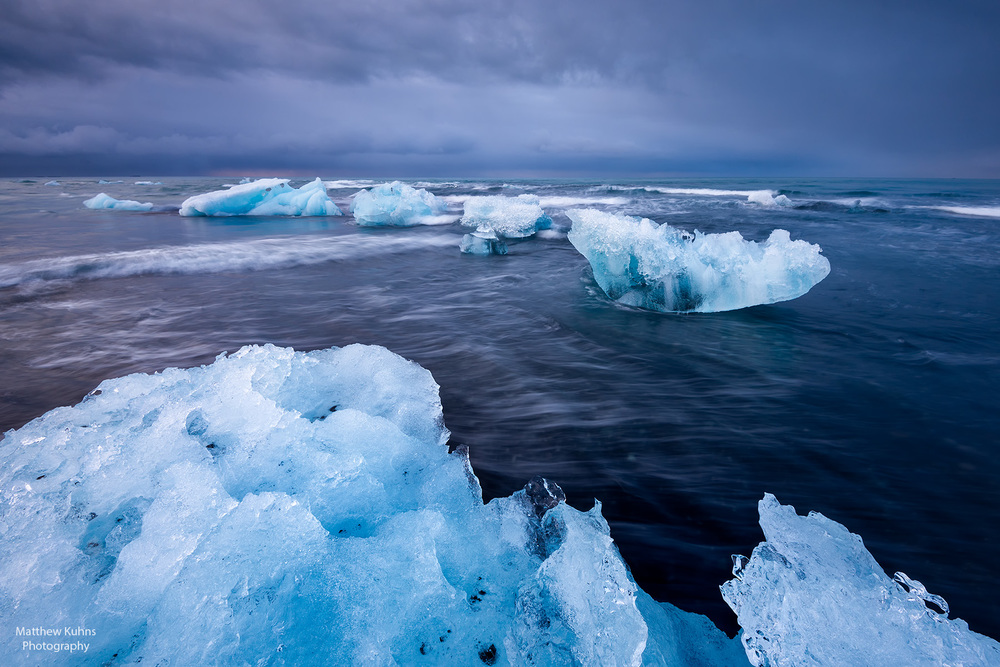 Click to Enlarge.  Icebergs in the surf at Jokulsarlon.