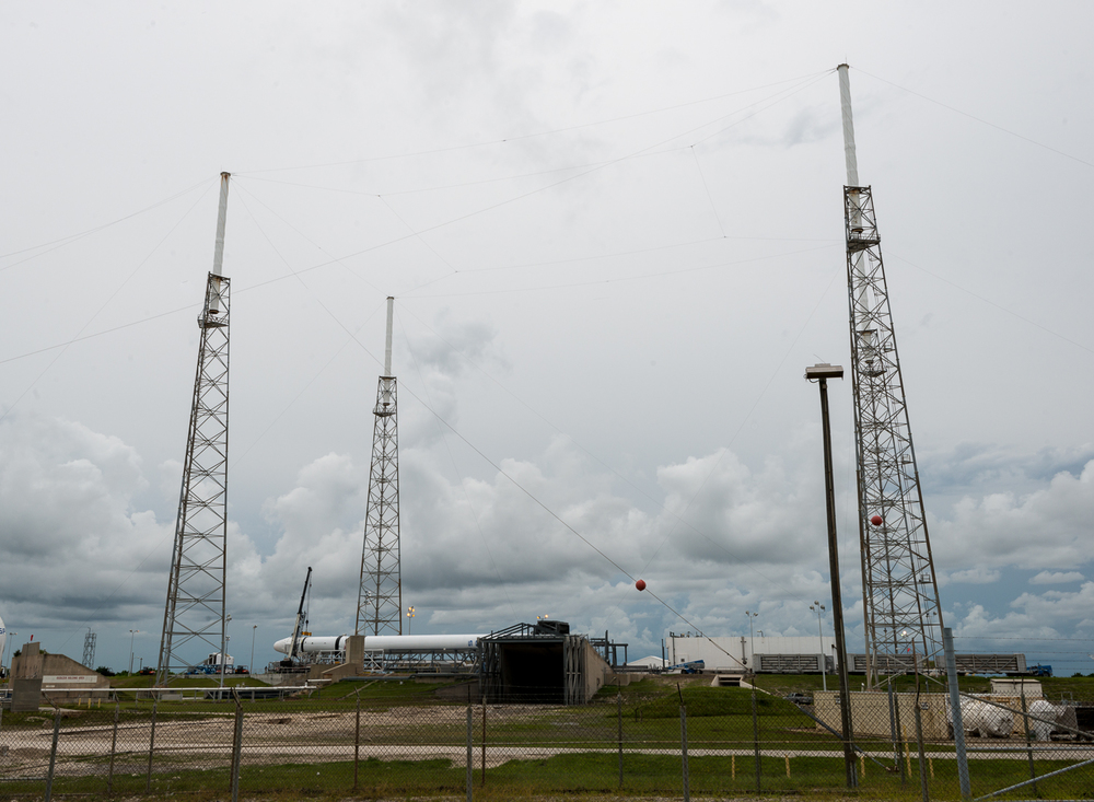 A view of the Space X pad with the Falcon 9 on its side.