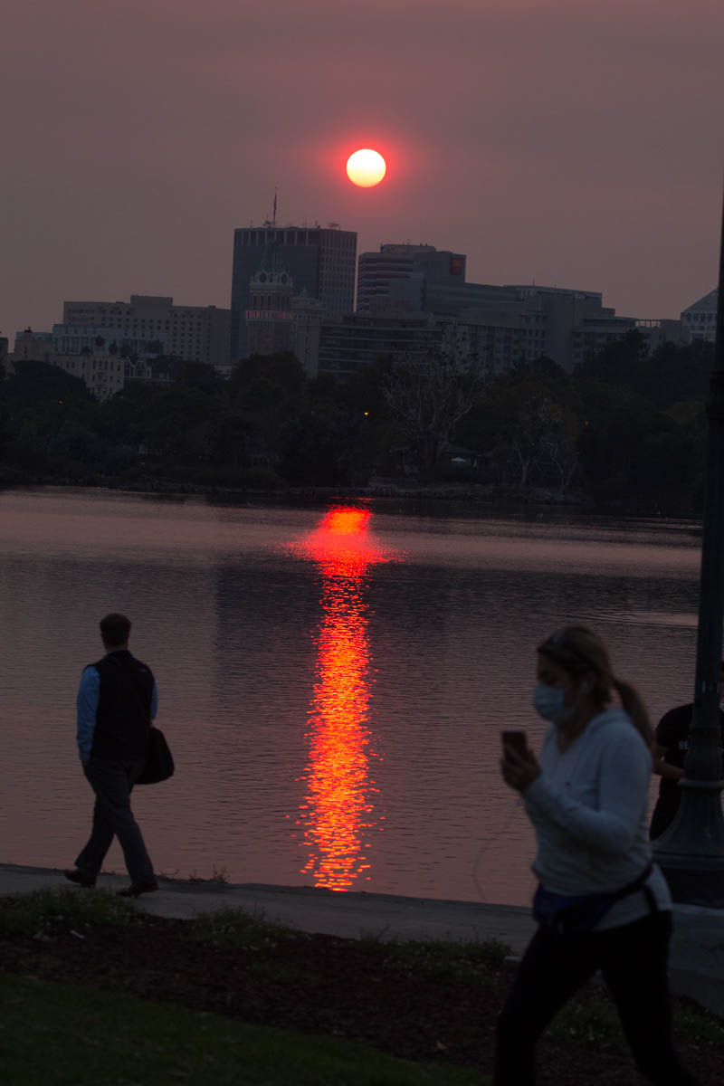 Unhealthy levels of smoke from massive wildfires to the north blot out the sun above Oakland's Lake Merritt. 10/12/17
