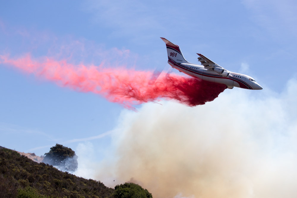 An airtanker drops retardant on a 20-acre fire in the Oakland hills. September 2017