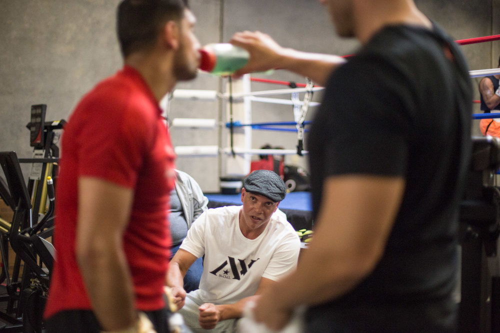 Boxer Amir Khan listens to his coach while training for a fight against Canelo Alvarez. San Leandro, CA. April 2016.