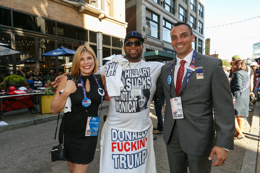 Republican delegates pose with man selling pro-Trump/anti-Clinton t-shirts. Cleveland, OH June 2016