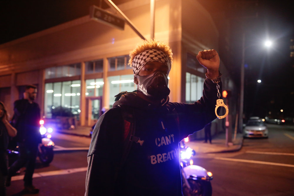 A man marches in the third night of anti-Trump protests following the election. Oakland, CA. Nov 2016