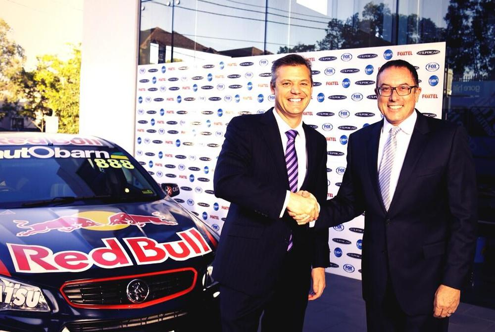 V8 Supercars CEO James Warburton and Fox Sports CEO Patrick Delany shake hands to the new broadcast deal.