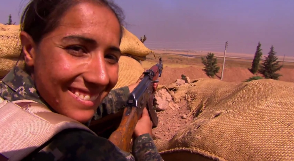 Kurdish female freedom fighters ready to defend against ISIS.  image - NIne Network