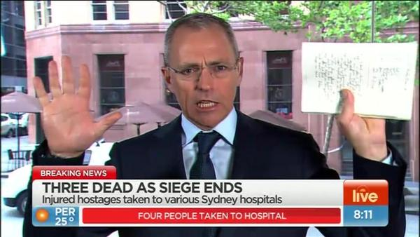 Chris Reason reporting from an evacuated Seven Studio in front of the Lindt Cafe. image source - Twitter @PeterDoherty7