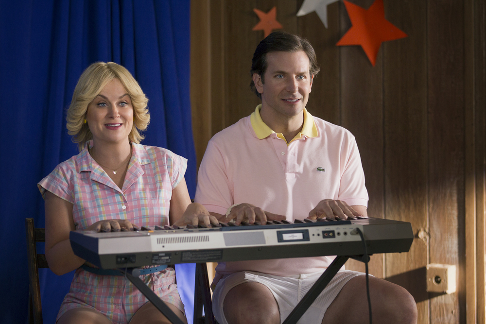 "Amy Poehler and Bradley Cooper in the Netflix original series ""Wet Hot American Summer: First Day Of Camp"". Photo by: Saeed Adyani/Netflix"