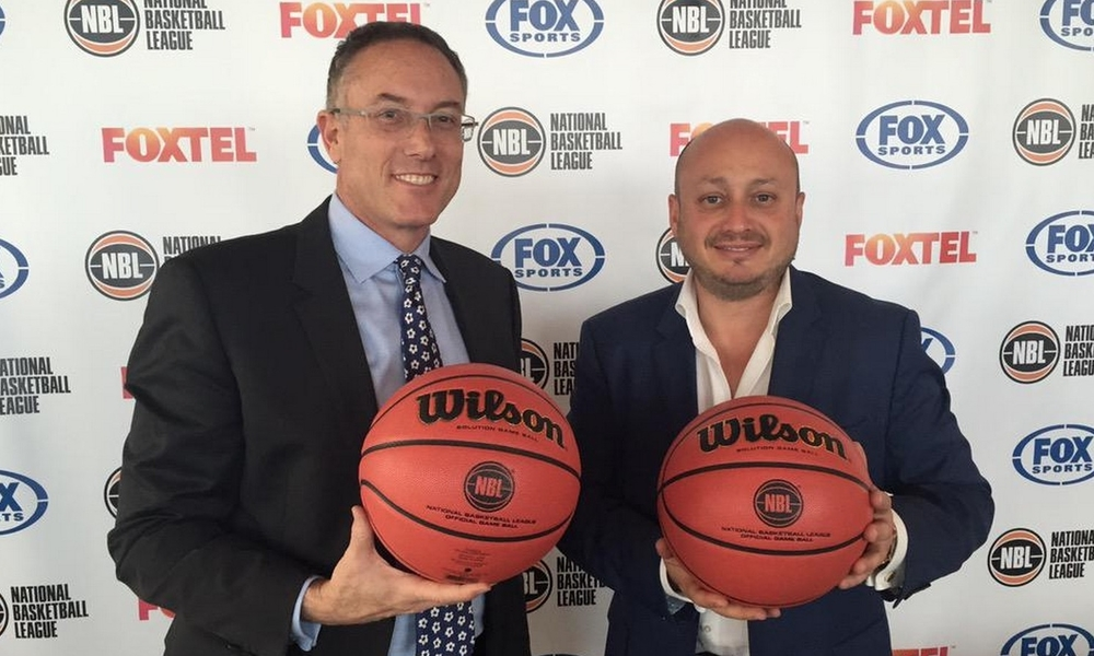 Fox Sports CEO Patrick Delany and NBL Executive Director Larry Kestelman celebrate new broadcast deal.  image source - Twitter  @PatrickDelany