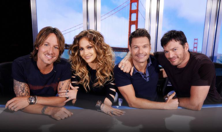 Judges - Keith Urban, Jennifer Lopez and Harry Connick Jr (right), with host Ryan Seacrest. image source - American Idol