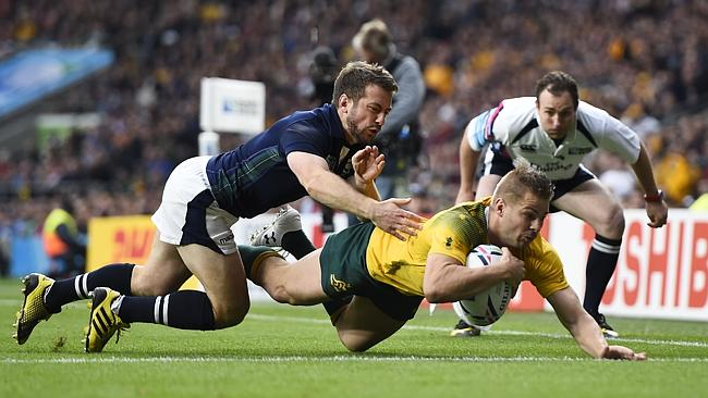 Drew Mitchell in the process of scoring against Scotland in the World Cup Semi-Final at Twickenham. image copyright - Reuters