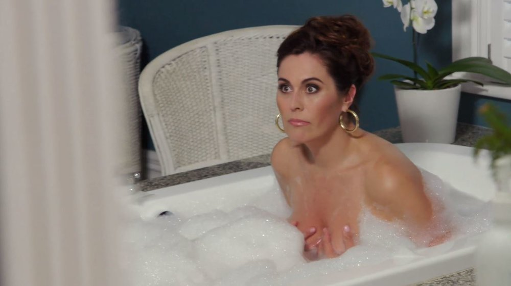 The REAL Angela getting a REAL photo in a REAL bath for her REAL book. REALLY.  Image - Foxtel