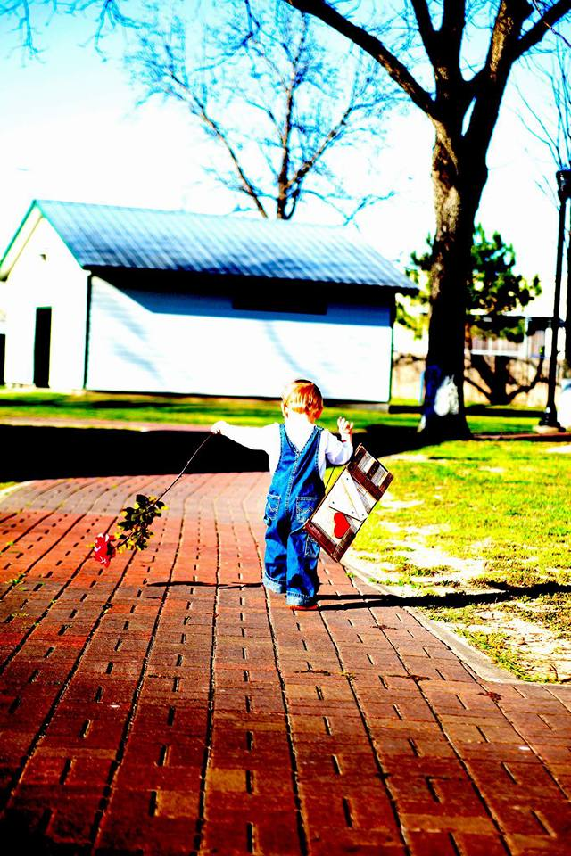 Love: I am in love with this photo of Anthony. He took his flower and love sign waved and said bye bye mommy and continued down the path. Then I asked for a hug. He dropped everything and ran back for a hug. Mary Weber Bunevich