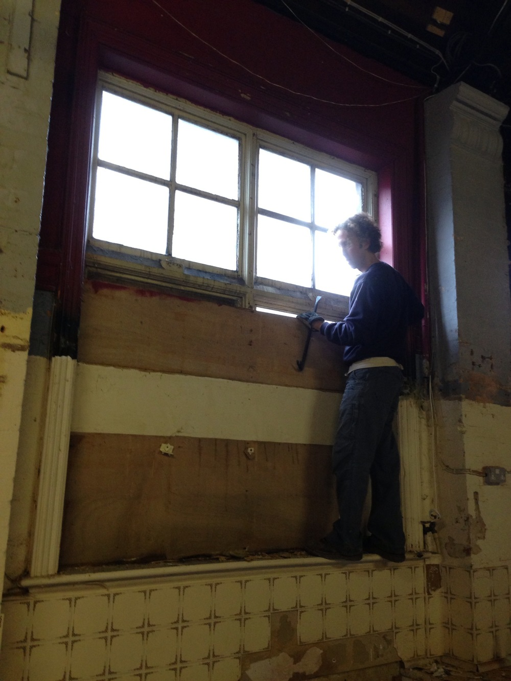 Un-boarding the window to let the fist bit of natural light into The Hall for 60 years.