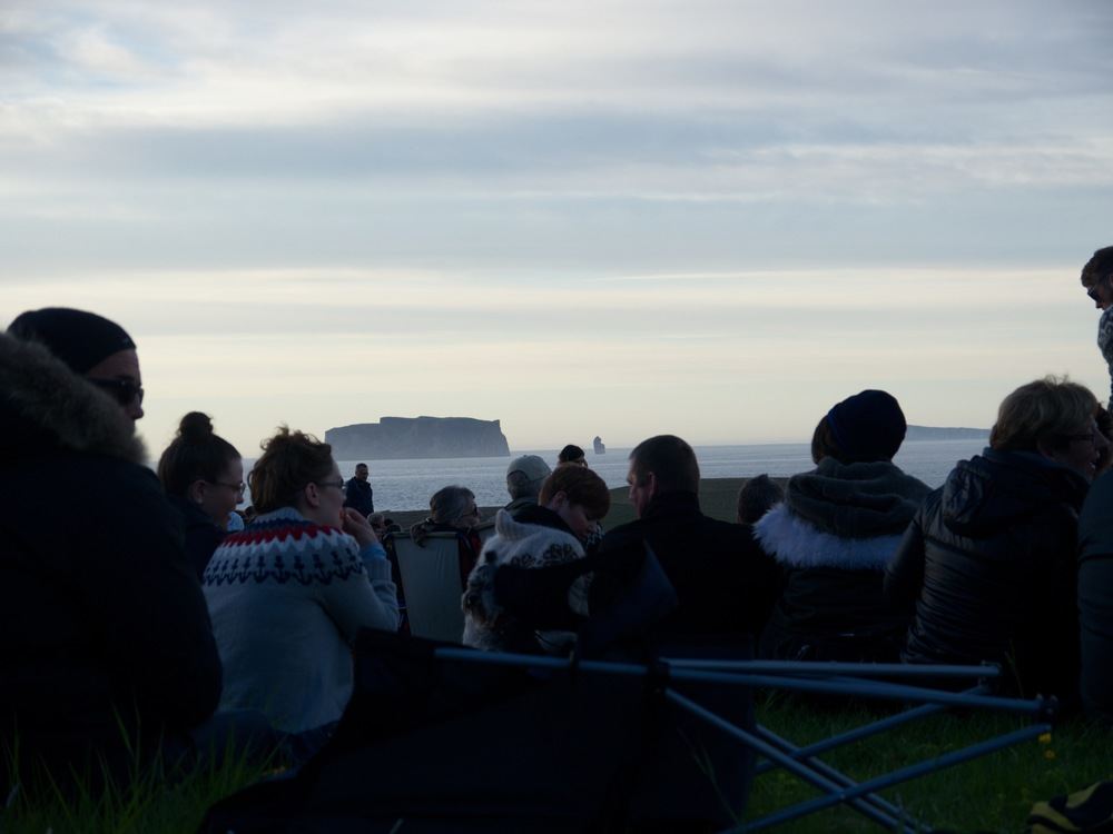 Reykir, Iceland- Music festival overlooking Drangey Island. Icelanders in their typical wool sweaters, usually knit by their grandmothers.   This is the darkest it ever gets in the summer.
