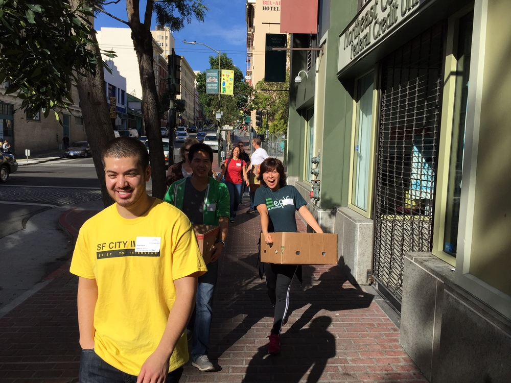 Meal delivery volunteers walking along Jones street