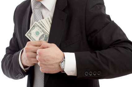 Agent with cash in pocket iStock_000016530240XSmall.jpg