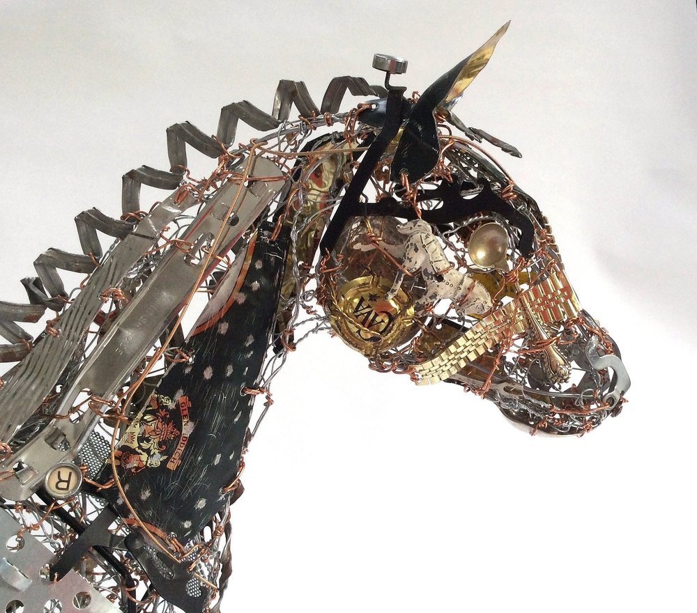 You can see one of the toy horses under the eye  which is made from an antique spoon.