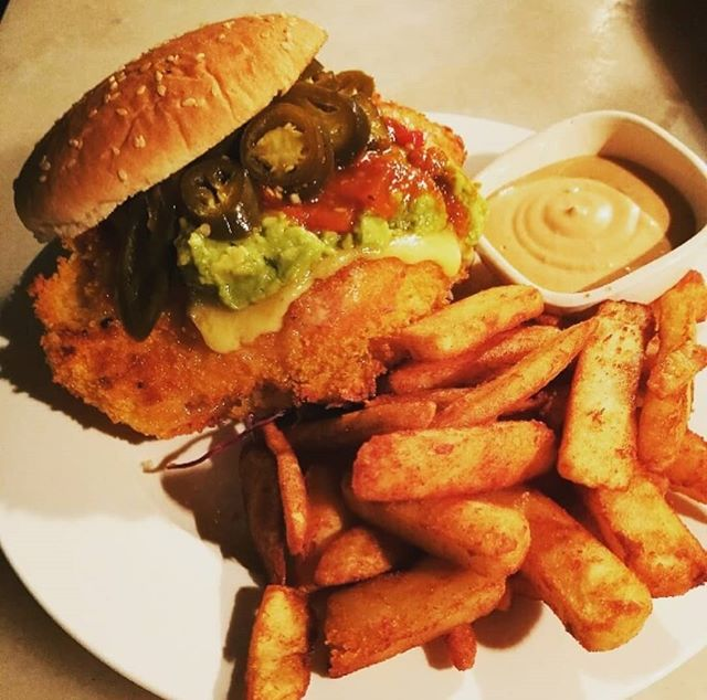 Our Mexican schnitzel burger is fast becoming one of our most popular meals. Come in and see what all the fuss is about. . #burger #mexican #yummm #charitycantina