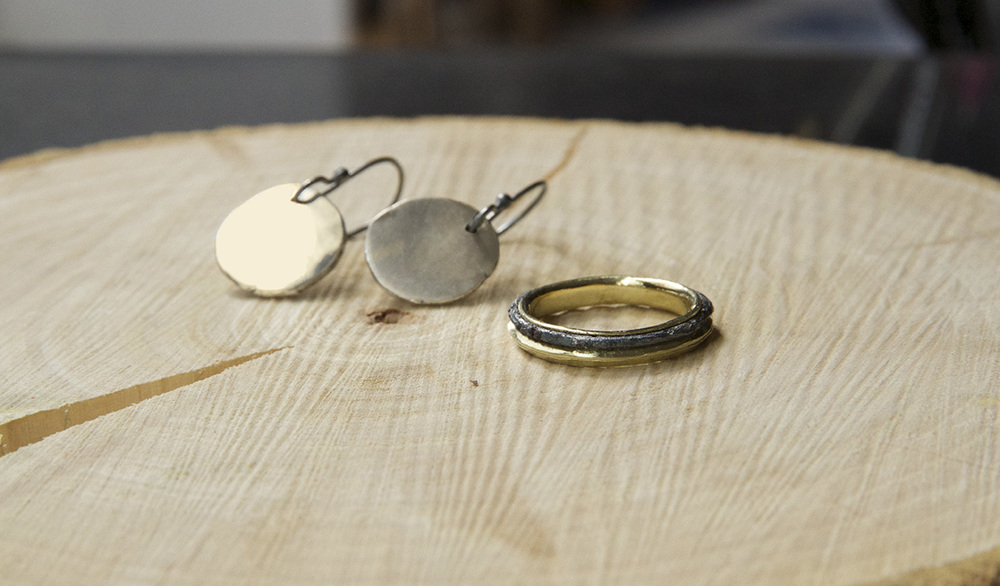 Gold earrings for Liz Summerville and a gold/wrought iron wedding ring for Brian Rice and Jacy Wall. The wrought iron came from a horseshoe found in the grounds of their farmhouse
