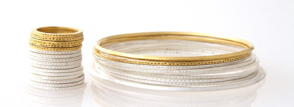 Whitened silver rings and bangles with 18ct gold friends from our  'Archaeology'  collection