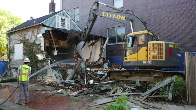 Excavator demolishing a tear-down house in Chicago.