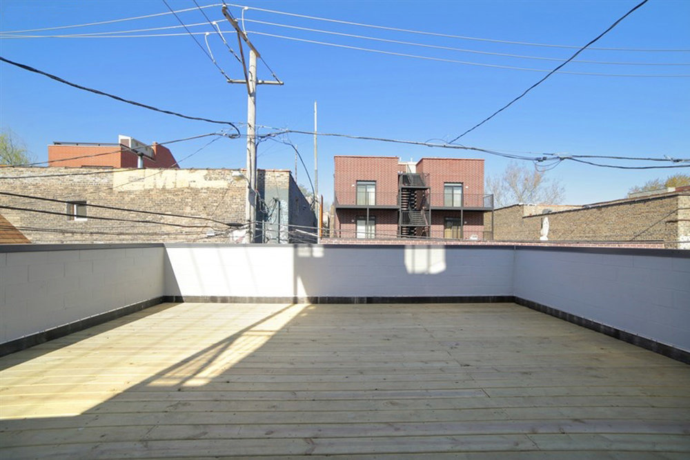 2903 W Lyndale St Unit 1-garage deck.jpg
