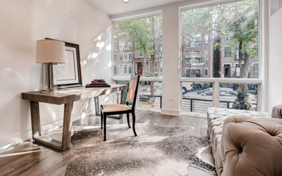 desk in home office with large window